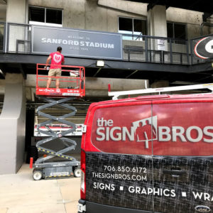 sign installation at athletic facility